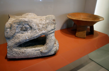 """A stone carving that depicts the """"Head of Snake"""" is displayed at Mexico's archaeology museum opening exhibition of artefacts discovered over the last 40 years, during a media tour at the Templo Mayor Aztec complex in Mexico City"""