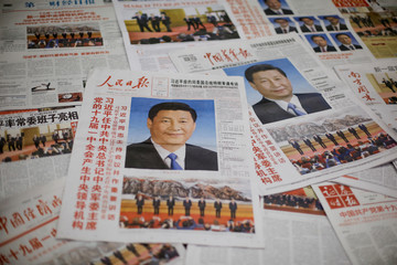 Photo illustration shows the front page of Communist Party's flagship newspaper the People's Daily and other newspapers one day after the unveiling of the new Politburo Standing Committee in Beijing