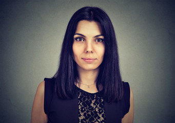 Portrait of a serious young woman looking at camera