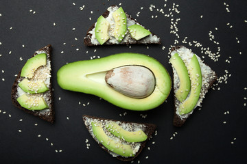 Sandwiches of rye bread with avocado and cream cheese, top view.