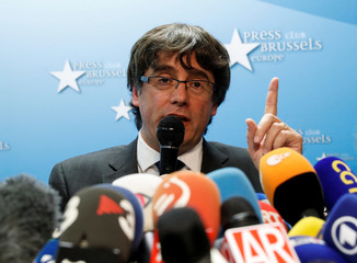 Sacked Catalan leader Carles Puigdemont attends a news conference at the Press Club Brussels Europe in Brussels