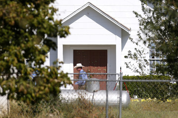 A law enforcement officer walks past the entrance to the First Baptist Church of Sutherland Springs, the site of the shooting, in Sutherland Springs