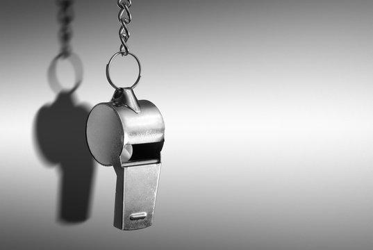 Hanging metal whistle closeup photo
