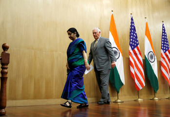 U.S. Secretary of State Rex Tillerson departs with Indian Foreign Minister Sushma Swaraj, after their media availability at the Indian Foreign Ministry in New Delhi