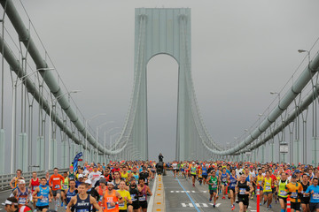 The first wave of runners make their way across the Verrazano-Narrows Bridge during the start of the New York City Marathon in New York