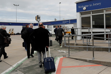 Passengers walk into the Jersey Airport terminal in St Peter