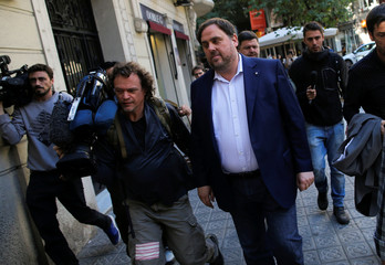 Sacked Catalan vice-president Oriol Junqueras walks down the street after leaving anb Esquerra Republicana de Catalunya (ERC) party meeting in Barcelona