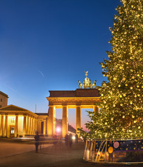 Brandenburger Gate in Berlin with Christmas tree at night