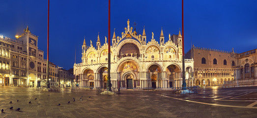 Basilica in San Marco square in Venice at night, panoramic image