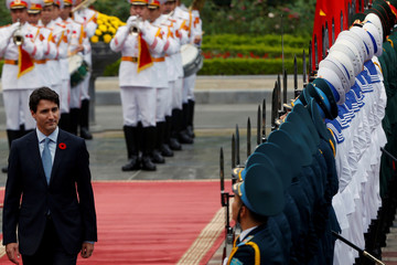 Canada's Prime Minister Justin Trudeau reviews the guard of honour during a welcoming ceremony at the Presidential Palace in Hanoi