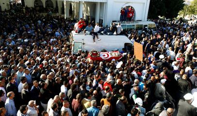 Relatives and colleagues carry the coffin of Tunisian police officer Riadh Barrouta who died after a knife attack near the parliament building in Tunis