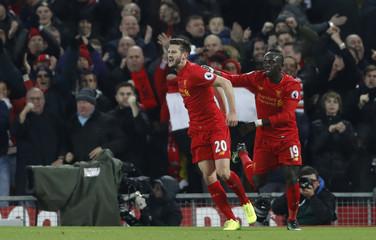 Liverpool's Adam Lallana celebrates scoring their first goal with Sadio Mane