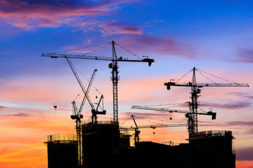 Beautiful urban construction site silhouettes at sunset