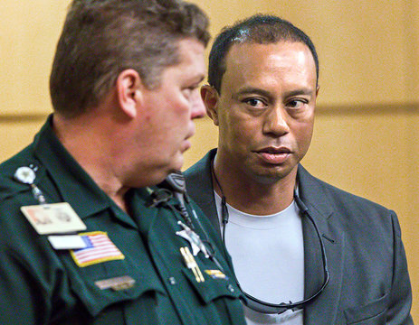 Golfer Woods leaves Palm Beach County court after he pleaded guilty to a charge of reckless driving in Palm Beach