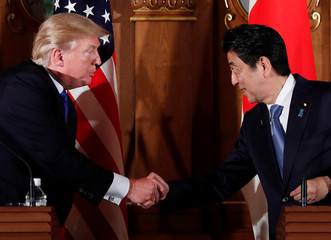 U.S. President Donald Trump and Japan's Prime Minister Shinzo Abe shake hands during a news conference at Akasaka Palace in Tokyo