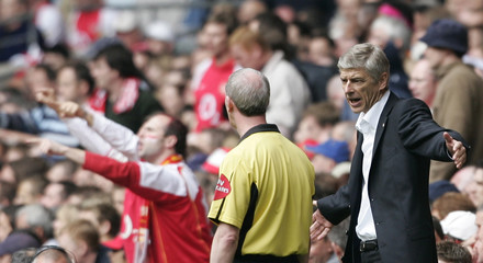 Arsenal's manager Wenger makes a point to the fourth official during FA Cup final against Manchester ...