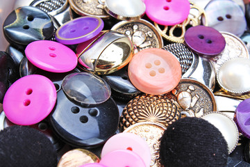 Buttons background. Colored shiny clothing button texture. Colored sewing buttons pattern concept wallpaper. Mixed colors. Studio photo texture photography. Button texture.