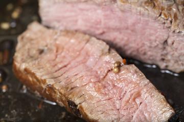 a sliced filet steak in a pan