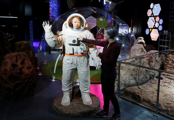 """A man tries a breadboard of Soviet lunar survival suit """"Krechet"""" at the Mission Mars exhibition by the Newton Park interactive museum of science together with the children's technopark Quantorium in Krasnoyarsk"""