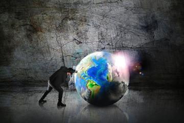businessman push the world