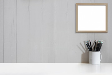 Mock up office desk and frame poster. Minimalist