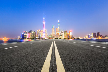 Asphalt road and modern city famous architectural scenery in Shanghai at night,China