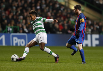 Celtic's Scott Sinclair in action with Barcelona's Lionel Messi