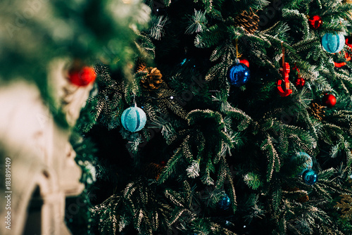 christmas greeting card with fir branches and wooden jingle bell christmas decoration with baubles