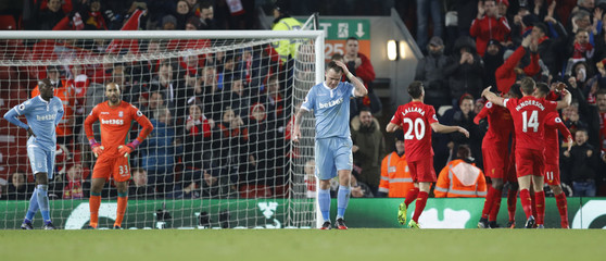 Stoke City's Glenn Whelan looks dejected after Giannelli Imbula scored an own goal and the third goal for Liverpool