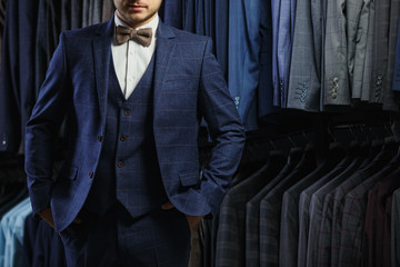Stylish man in suit. Business style. Fashionable image. Office worker. Sexy man standing