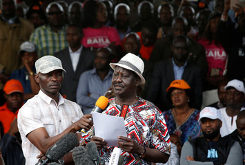 Kenyan opposition leader Raila Odinga, the presidential candidate of the National Super Alliance (NASA) coalition, addresses his supporters during a rally at the Uhuru Park in Nairobi