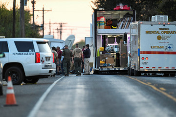 Medical personnel and law enforcement set up along a street near the First Baptist Church in Sutherland Springs, Texas