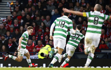 Celtic's James Forrest celebrates scoring their second goal with teammates