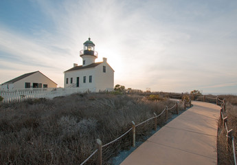 OLD POINT LOMA LIGHTHOUSE AT CABRILLO NATIONAL MONUMENT UNDER BLUE CIRRUS CLOUDSCAPE AT POINT LOMA SAN DIEGO IN SOUTHERN CALIFORNIA UNITED STATES