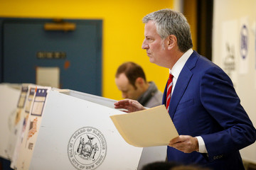 New York City Mayor De Blasio holds his ballot for re-election in the Brooklyn borough of New York