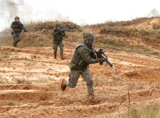 Spanish Army soldiers run during Silver Arrow 2017 military drills in Adazi