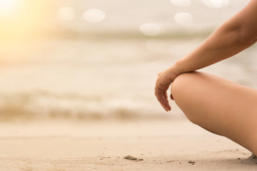 Woman In Relaxation On Tropical Beach with sand , body parts .yoga, and meditation