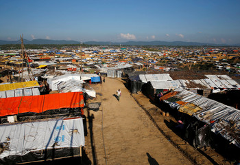 A Rohingya refugee walks at the Kutupalong refugee camp near Cox's Bazar