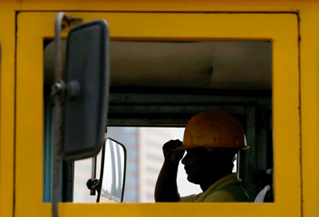 A truck driver wears his safety helmet before starting work at Colombo Port City construction site in Colombo