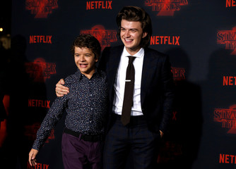 "Cast members Keery and Matarazzo pose at the premiere for the second season of the television series ""Stranger Things"" in Los Angeles"