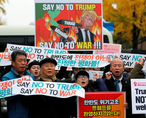 Protesters take part in a rally against U.S. President Donald Trump near South Korea's presidential Blue House in central Seoul