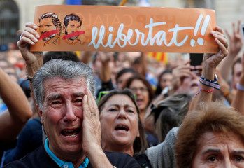 People react at Sant Jaume Square after Catalan regional parliament declares independence from Spain in Barcelona