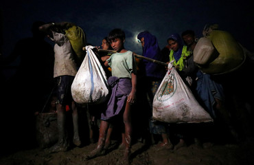 Rohingya refugees continue their journey after crossing the Myanmar-Bangladesh border in Palong Khali