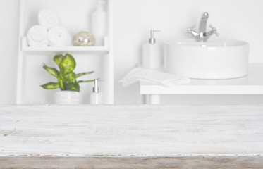 Wooden table over blurred spa salon bathroom shelves background