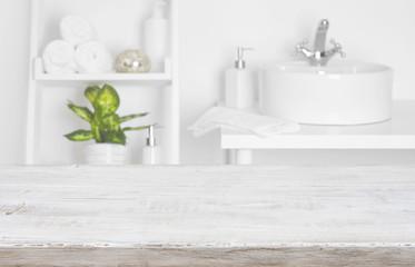 Wooden table over blurred spa salon bathroom shelves background