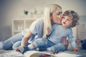 Mother share love with her son have playing together.
