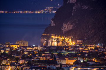 View of the beautiful Lake Garda .Riva del Garda town and Garda lake by night, Italy