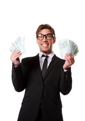 Picture of happy businessman in suit with euros at hands