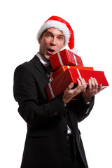 Image of man in business suit, santa hat with gifts in boxes