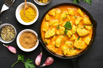 Chicken curry in frying pan